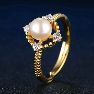white pear ring with gemstone