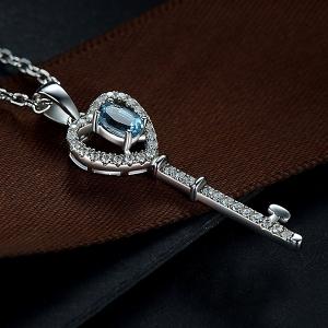 key pendant with gemstone
